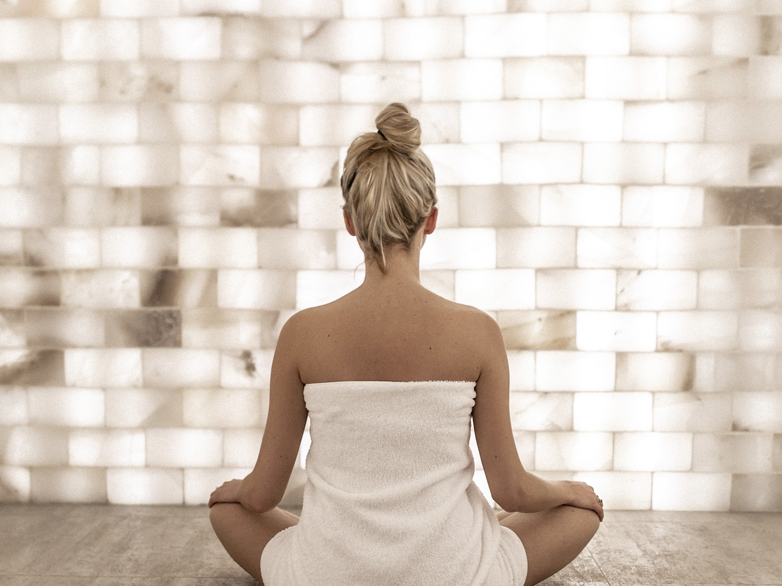 A girl meditating in the salt room at Spa William Gray